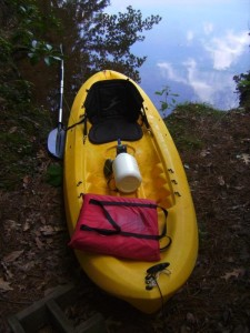 Protein shake container as dry storage on kayak