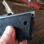 SR1911 .45 Auto Pistol Hogue Grip Installation - line up the screw holes
