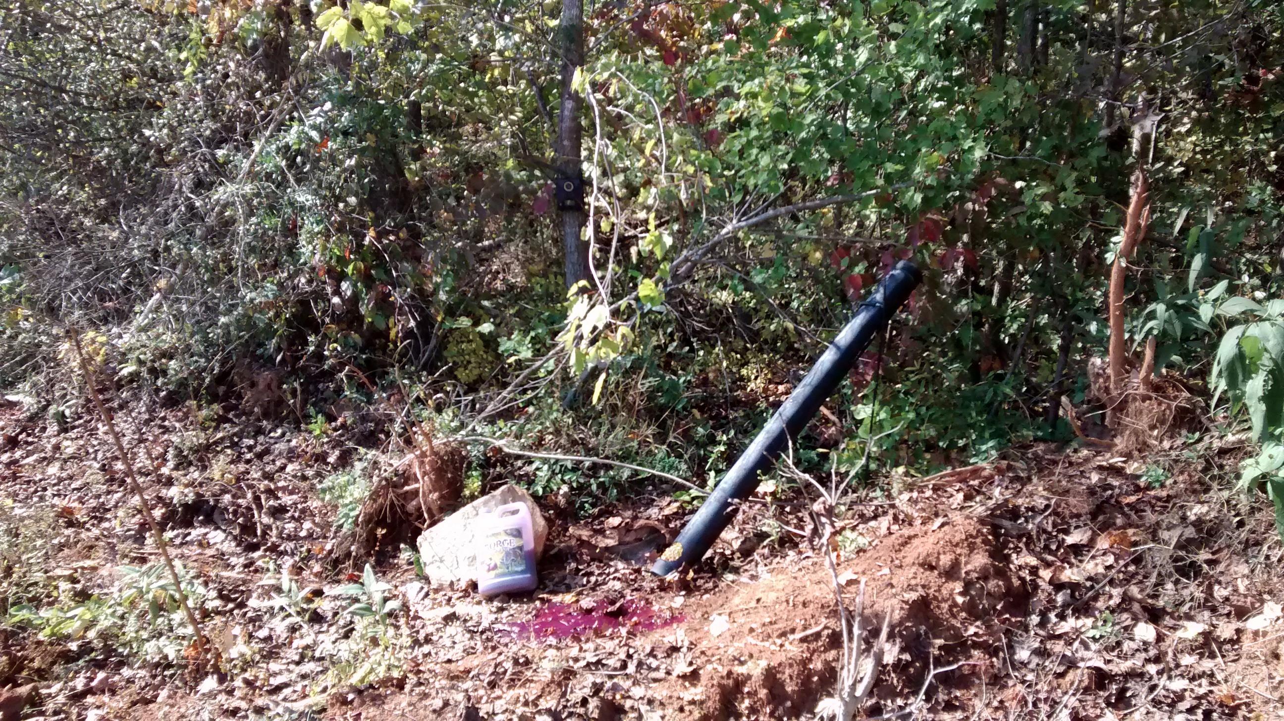DIY PVC deer feeder 4″ sewer pipe in field with liquid attractant