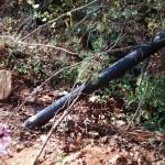 """DIY PVC deer feeder 4"""" sewer pipe in field - camo"""