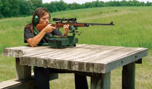 Caldwell Lead Sled Plus Recoil Reducing Rifle Rest - girl at heavy shooting bench